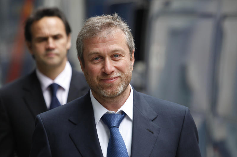 FILE  This Tuesday, Oct. 4, 2011 file photo shows the owner of England's Chelsea Football Club, Russian tycoon Roman Abramovich as he leaves court in London.  Russian businessmen  Roman Abramovich and Boris Berezovsky. rose to riches together in the chaotic years of post-Soviet Russia and then became archenemies and a British judge will soon rule on which oligarch will defeat the other in a multi-billion-dollar court battle. After a seven-month delay, Judge Elizabeth Gloster  is expect to deliver a summary ruling Friday Aug. 31, 2012 to settle the legal feud between Roman Abramovich, the billionaire Chelsea Football Club owner, and self-exiled tycoon Boris Berezovsky.  (AP Photo/Lefteris Pitarakis, File)