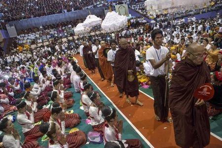 Leaders of radical Buddhist group Ma Ba Tha arrive during a celebration of the recent establishment of four controversial bills decried by rights groups as aimed at discriminating against the country's Muslim minority, at a rally in a stadium at Yangon October 4, 2015. REUTERS/Soe Zeya Tun
