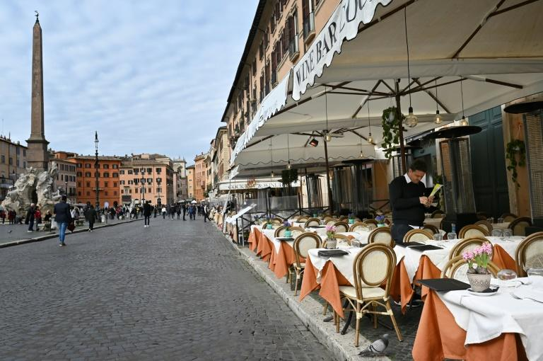 Many outdoor restaurants and cafes in Rome have either closed or have empty tables overseen by gloomy staff