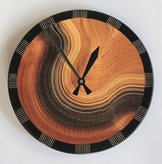 """This clock design is the creation of craftsmen Ingela Noren and Daniel Grant. The piece is handmade using milk paints and lacquering technique. It measures 10 inches in diameter. $170, Artful Home. <a href=""""https://www.artfulhome.com/product/Wood-Wall-Clock/Burl-Comb-Wall-Clock/124540"""" rel=""""nofollow noopener"""" target=""""_blank"""" data-ylk=""""slk:Get it now!"""" class=""""link rapid-noclick-resp"""">Get it now!</a>"""