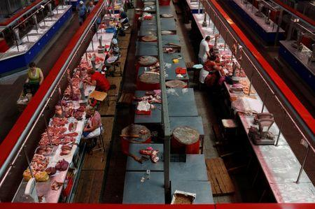 Vendors wait for customers at a meat market in Rostov-on-Don, Russia July 2, 2018. REUTERS/Murad Sezer