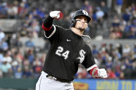Chicago White Sox catcher Yasmani Grandal (24) celebrates his fourth-inning home run as he round the bases during a baseball game against the Texas Rangers in Arlington Texas, Sunday, Sept. 19, 2021. (AP Photo/Matt Strasen)
