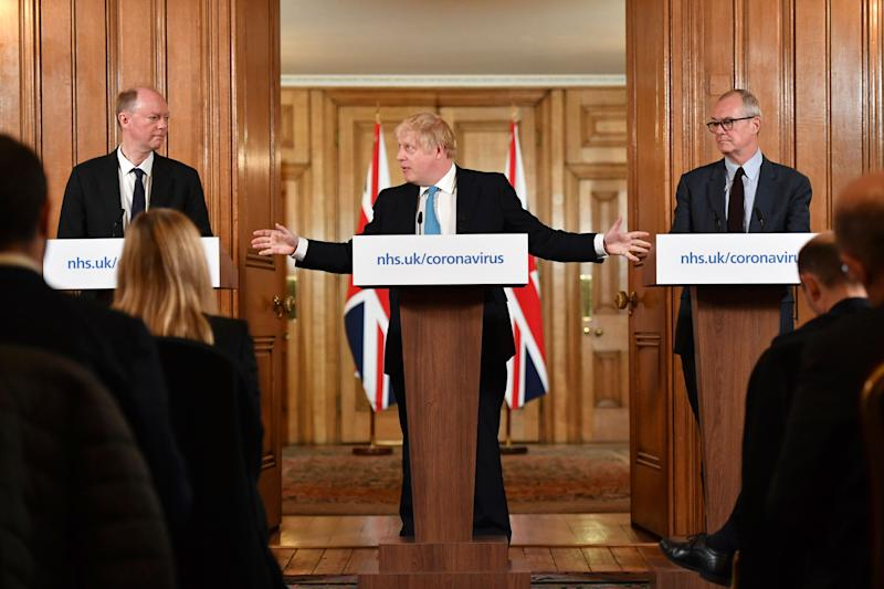 <strong>Britain's Prime Boris Johnson, centre, gestures to Chief Medical Officer Professor Chris Whitty, left and Chief Scientific Adviser Patrick Vallance, during a coronavirus news conference earlier this month.</strong> (Photo: ASSOCIATED PRESS)