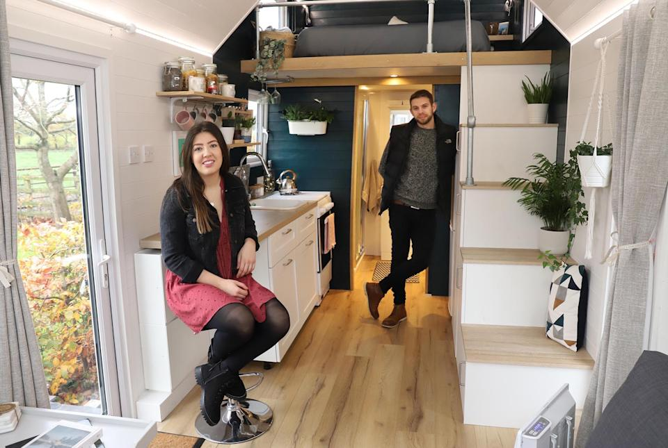 Grace Stringer and her partner Craig Jukes are thrilled with their tiny house. (Caters)