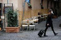 Empty cafes in Italy as large parts of the country return to lockdown