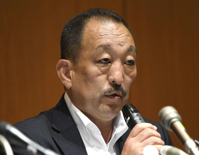Kwansei Gakuin head coach Hideaki Toriuchi speaks during a press conference in Nishinomiya, western Japan Thursday, May 17, 2018. The head coach of Nihon University football team has denied instructing his players to commit fouls against opponents after footage of a controversial tackle went viral. In the video played widely on Japanese television, a Kwansei Gakuin quarterback is blindsided with a late hit by a Nihon University player in the May 6 game. (Koki Sengoku/Kyodo News via AP)