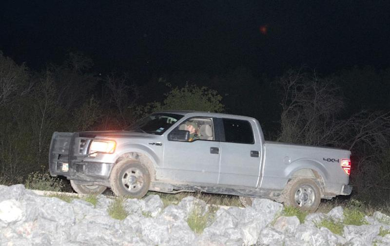 A Border Patrol agent in an unmarked vehicle drives out of US Fish and Wildlife land where a fellow agent was suspected of stabbing a woman and a child, as well as kidnapping another child Wednesday March 12, 2014, near Abram, Texas. Esteban Manzanares kidnapped and assaulted three immigrants from Honduras. Manzanares shot himself in the head killing himself before FBI agents entered his apartment. (AP Photo/The Monitor, Nathan Lambrecht)