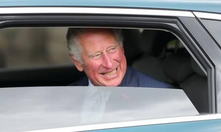 88675529_Britain's Prince Charles smiles as he departs after meeting key workers from Transport for.jpg