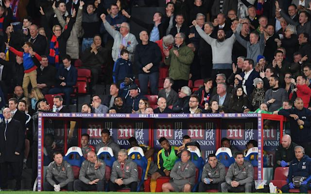 Crystal Palace fans celebrate their team's second goal Credit: Getty Images