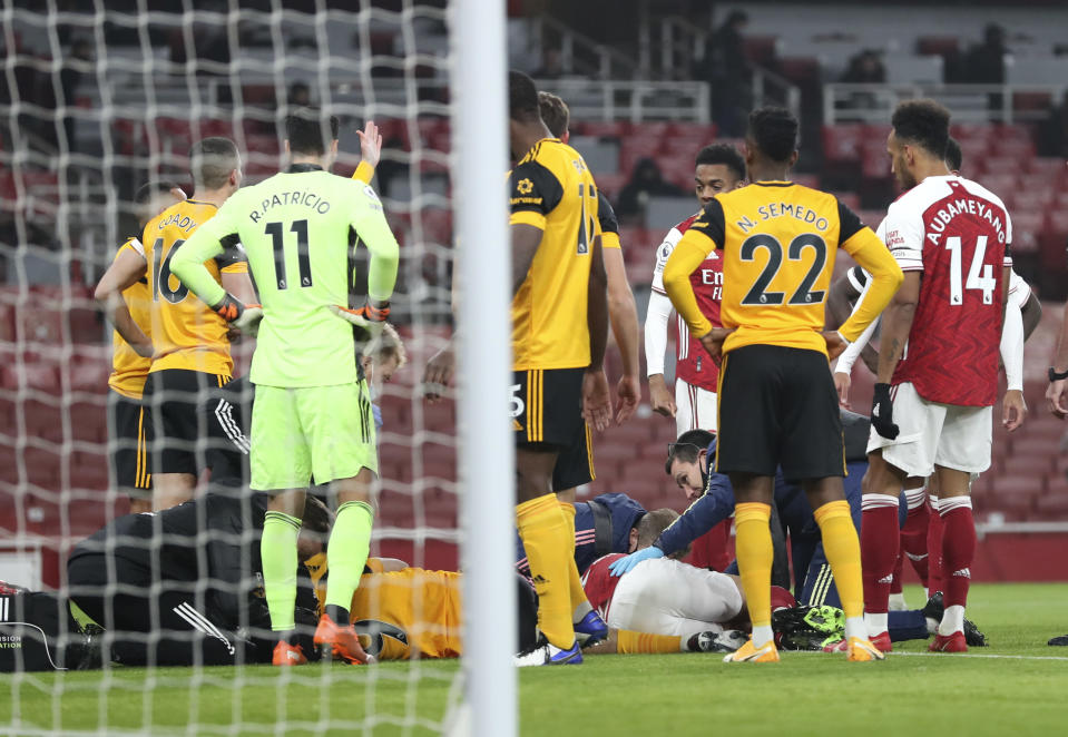 Wolverhampton Wanderers' Raul Jimenez and Arsenal's David Luiz are checked by medical staff following ahead clash during the English Premier League soccer match between Arsenal and Wolverhampton Wanderers at Emirates Stadium, London, Sunday, Nov. 29, 2020. (Catherine Ivill/Pool via AP)