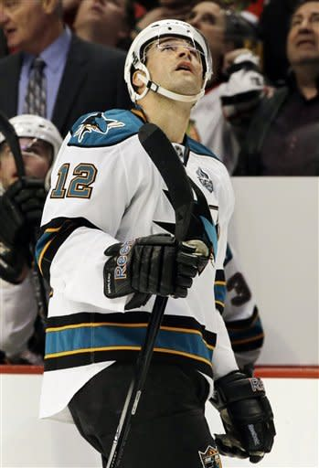 San Jose Sharks' Patrick Marleau (12) checks a score board after scoring his goal during the first period of an NHL hockey game against the Chicago Blackhawks in Chicago, Friday, Feb. 22, 2013. (AP Photo/Nam Y. Huh)