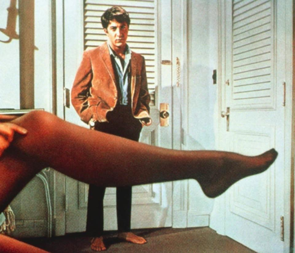"""The most famous line delivered by <strong>Dustin Hoffman</strong> in 1967's <em>The Graduate</em> is one that people get…well, mostly right. Hoffman as Ben Braddock actually says, """"Mrs. Robinson, you're trying to seduce me. Aren't you?"""" The way movie fans have reimagined the line actually changes the meaning slightly. The misquote is a direct question, but what Ben actually says has more uncertainty."""