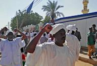 Sudanese protesters shout slogans against the government after prayers at a mosque in Khartoum's twin city Omdurman