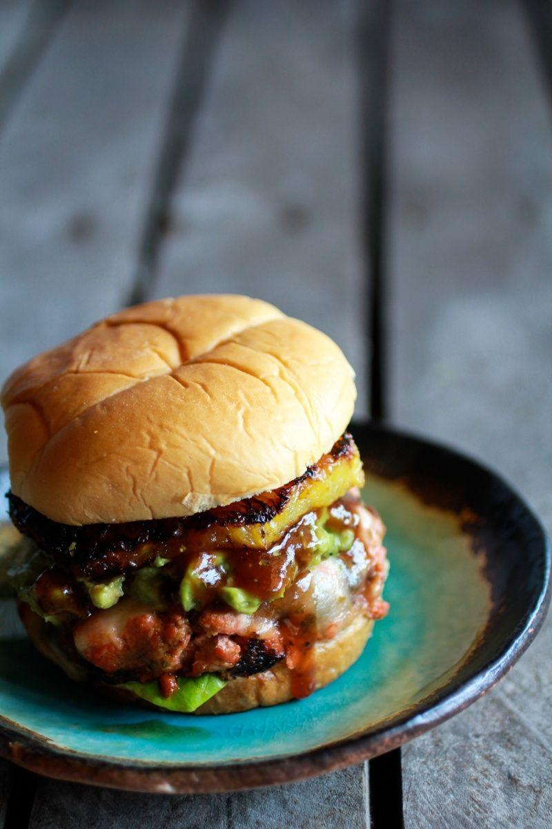 """<p>Barbecue sauce, juicy salmon, avocado, cheese, and caramelized pineapple combine to make this main course simply delicious. </p><p><strong>Get the recipe at <a href=""""http://www.halfbakedharvest.com/hawaiian-bbq-salmon-burgers-with-coconut-caramelized-pineapple/"""" rel=""""nofollow noopener"""" target=""""_blank"""" data-ylk=""""slk:Half Baked Harvest"""" class=""""link rapid-noclick-resp"""">Half Baked Harvest</a>.</strong> </p>"""