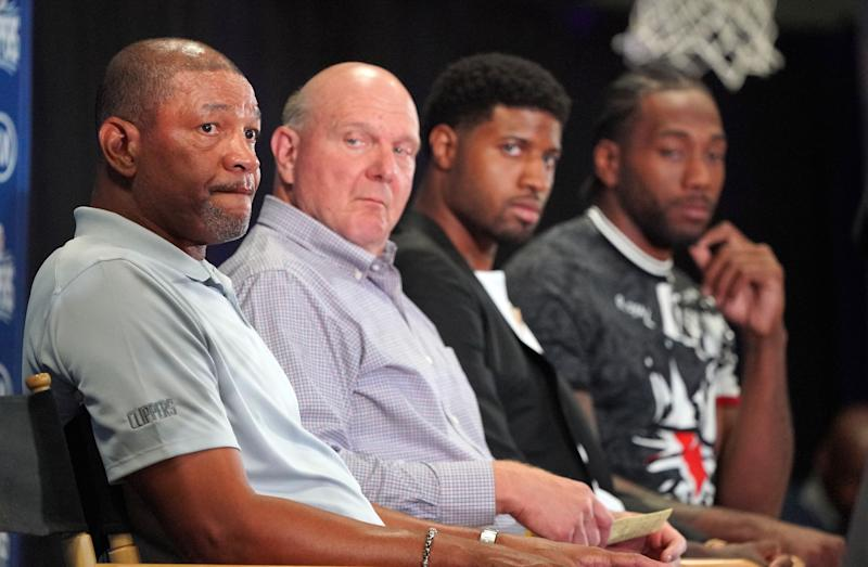 LOS ANGELES, CA - JULY 24: From left, Clippers head coach Doc Rivers, owner Steve Ballmer, Paul George and Kawhi Leonard gather for a press conference at the Green Meadows Recreation Center in Los Angeles on Wednesday, July 24, 2019. George and Leonard were introduced to the media and fans as the newest members of the Clippers. (Photo by Scott Varley/MediaNews Group/Daily Breeze via Getty Images)