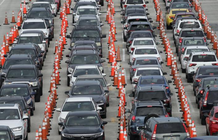 """<span class=""""caption"""">Lines of cars wait for a COVID-19 test in Miami Gardens, Florida. Drive-through testing sites can pose a challenge for people with disabilities.</span> <span class=""""attribution""""><a class=""""link rapid-noclick-resp"""" href=""""http://www.apimages.com/metadata/Index/Virus-Outbreak-Florida/d6f551571682430c8859b3da44b766af/18/0"""" rel=""""nofollow noopener"""" target=""""_blank"""" data-ylk=""""slk:AP Photo/Wilfredo Lee"""">AP Photo/Wilfredo Lee</a></span>"""
