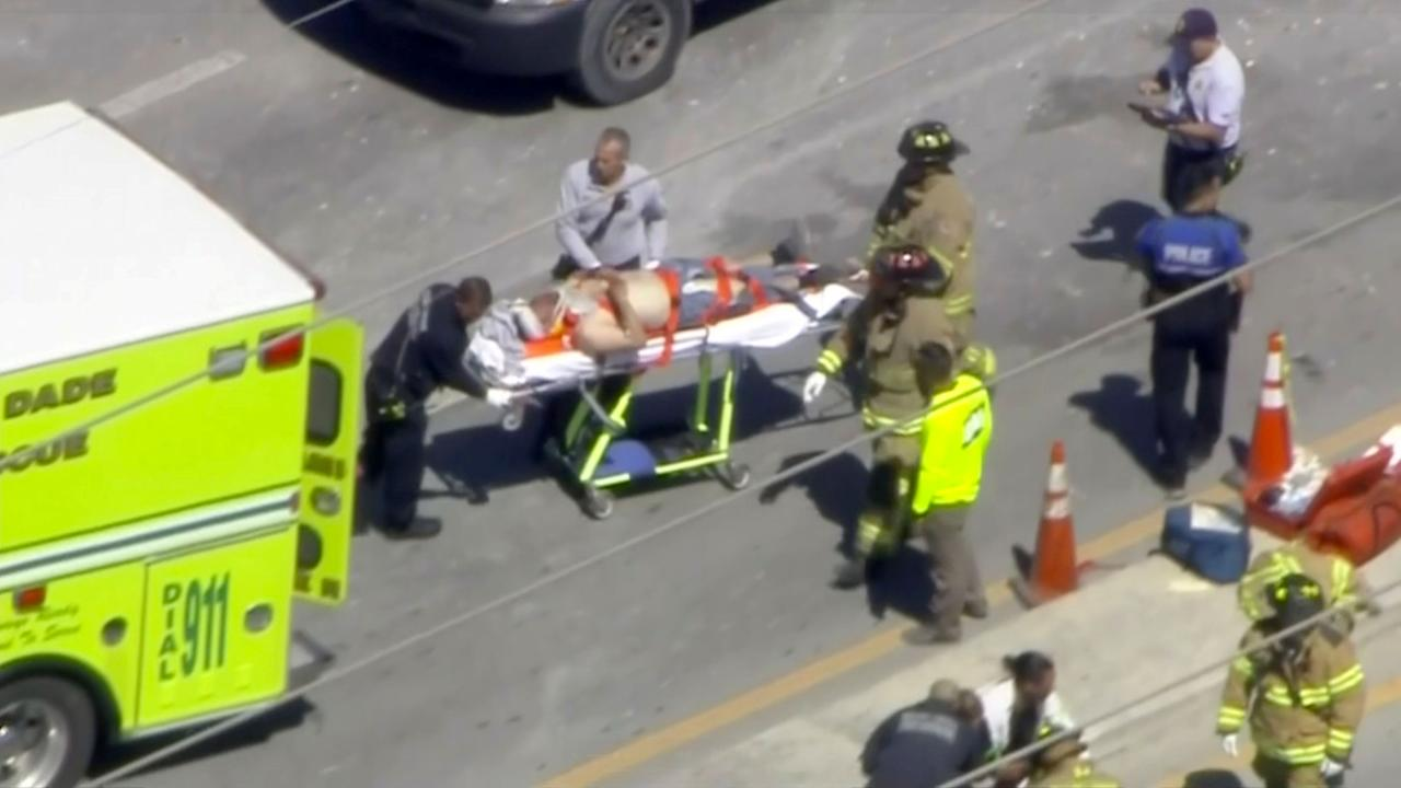 <p>Emergency crews load a victim into a rescue vehicle at the scene of a collapsed pedestrian bridge at Florida International University in Miami, Florida, U.S., March 15, 2018 in this still image from video. Photo from WTVJ-NBCMiami.com via REUTERS. </p>