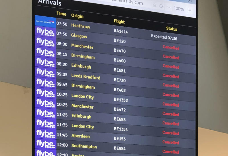 The flight departure boards shows cancelled flights at Belfast Airport in Belfast Thursday, March 5, 2020. The struggling British airline Flybe has collapsed, leaving passengers stranded and told to find their own way home. UK Civil Aviation Authority said in a statement Thursday that financially troubled Flybe had entered administration. (David Young/PA via AP)