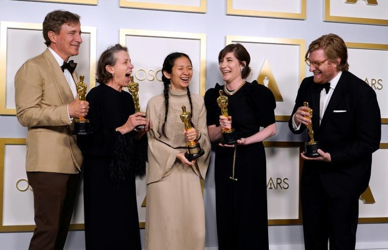 """(From L) Producers Peter Spears, Frances McDormand, Chloe Zhao, Mollye Asher and Dan Janvey revel in their Oscar win for best picture for """"Nomadland"""""""