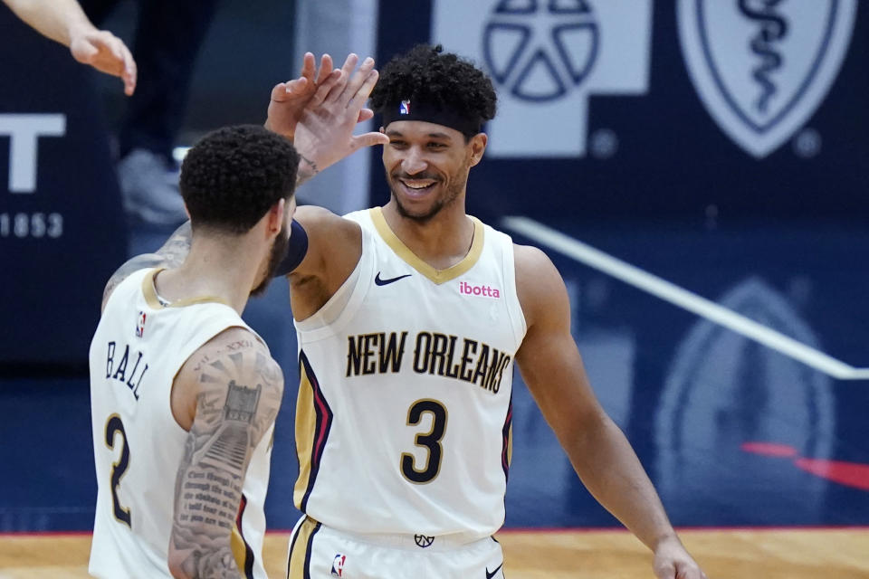 New Orleans Pelicans guard Josh Hart (3) celebrates his slam dunk with guard Lonzo Ball (2) in the final seconds of the second half of an NBA basketball game against the Utah Jazz in New Orleans, Monday, March 1, 2021. (AP Photo/Gerald Herbert)