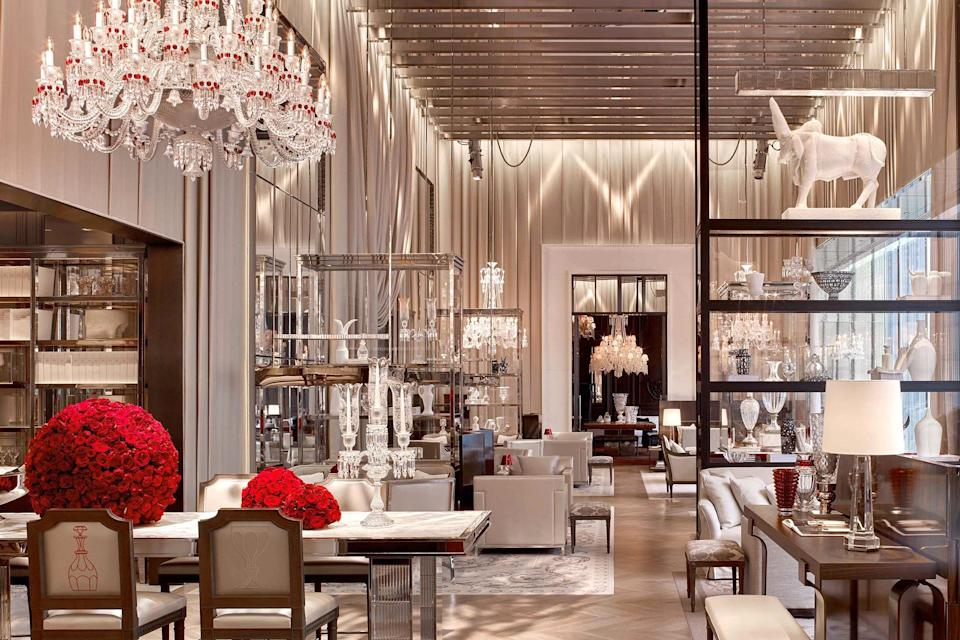 <p><strong>How did it strike you on arrival?</strong><br> Unabashed opulence is what you get as soon as you step into the lobby, and there's a feeling that no expense was spared. Fittingly for a hotel opened by the renowned crystal company, there are about 15,000 pieces of the brand's sparkle throughout, including glassware and chandeliers. Arrangements of fresh red roses everywhere add a touch of color.</p> <p><strong>What's the crowd like?</strong><br> Lots of international travelers occupy the hotel and, as expected, are well-off and well-dressed. And as the hotel is right across from the Museum of Modern Art, it's a place that naturally draws in contemporary art fans.</p> <p><strong>Most importantly: Tell us about your room.</strong><br> Parquet wood floors, sleek cream and white contemporary furniture, marble side tables, cashmere throws, and floor-to-ceiling windows all combine to create an atmosphere of supreme refinement.</p> <p><strong>We're craving some deep, restorative sleep. They got us?</strong><br> The bed is a dream, snowy white and extremely comfortable.</p> <p><strong>How about the little things, like mini bar, or shower goodies. Any of that worth a mention?</strong><br> Endless little touches are what make the hotel such a special experience, like the Baccarat tumblers in the bathroom and crystal sconces on the wall.</p> <p><strong>Please tell us the bathroom won't let us down.</strong><br> Pristine white marble bathrooms are large and include luxurious products from French perfumer Francis Kurkdjian.</p> <p><strong>We could all use some good Wi-Fi. What's the word on that?</strong><br> There is complimentary Wi-Fi.</p> <p><strong>Anything stand out about other services and features?</strong><br> The hotel is home to the only dedicated spa in the U.S. by cult beauty brand La Mer. The La Mer Miracle Broth Facial is a particularly popular treatment. The indoor pool is also a draw, and a new outdoor terrace, Le Jardin, is now open.</p> <p><strong>Wha