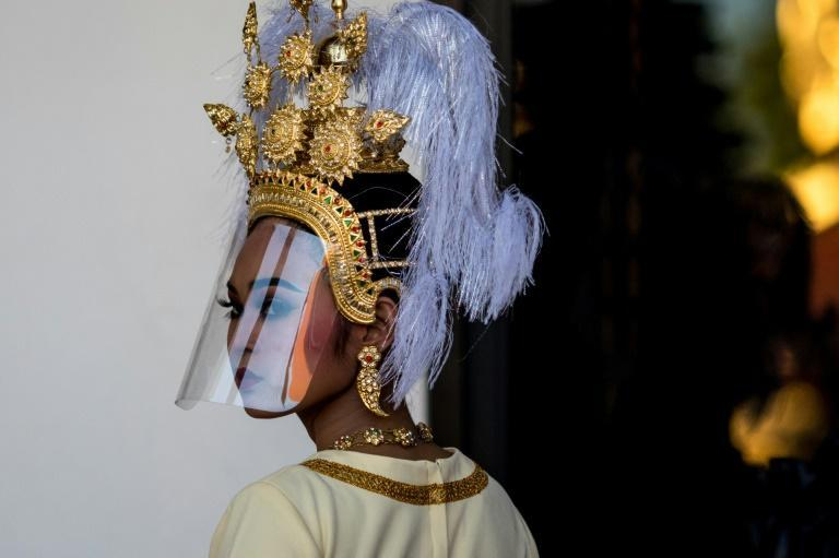 Traditional Thai dancers wore plastic face shields during an event to mark the return of two ancient sandstone lintels