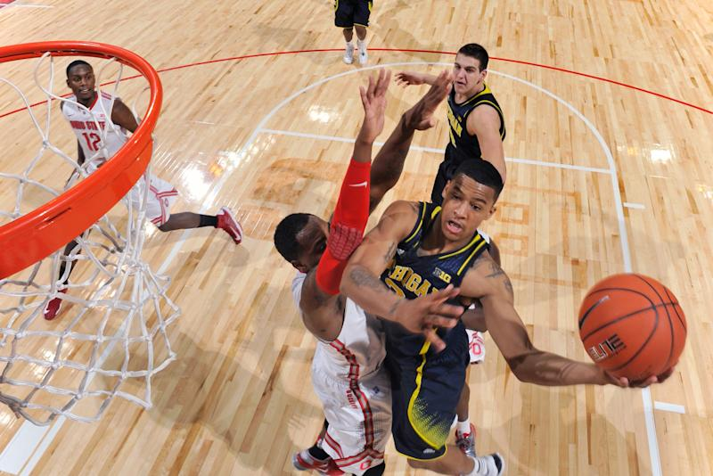 Trey burke trying to rekindle the fire not seen at for Cazzie russell mural