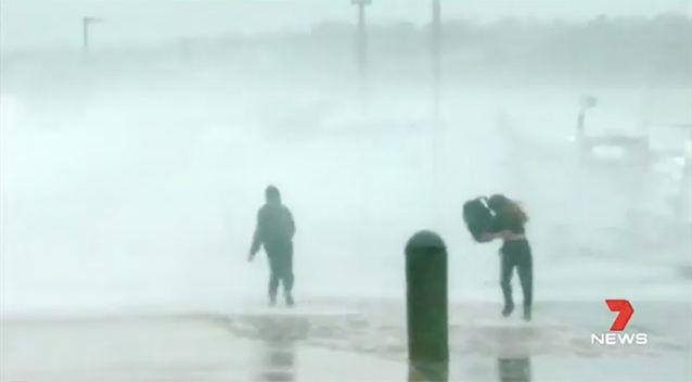 Tourists ran for cover as huge swells crashed over a Mornington Peninsula pier. Source: 7 News