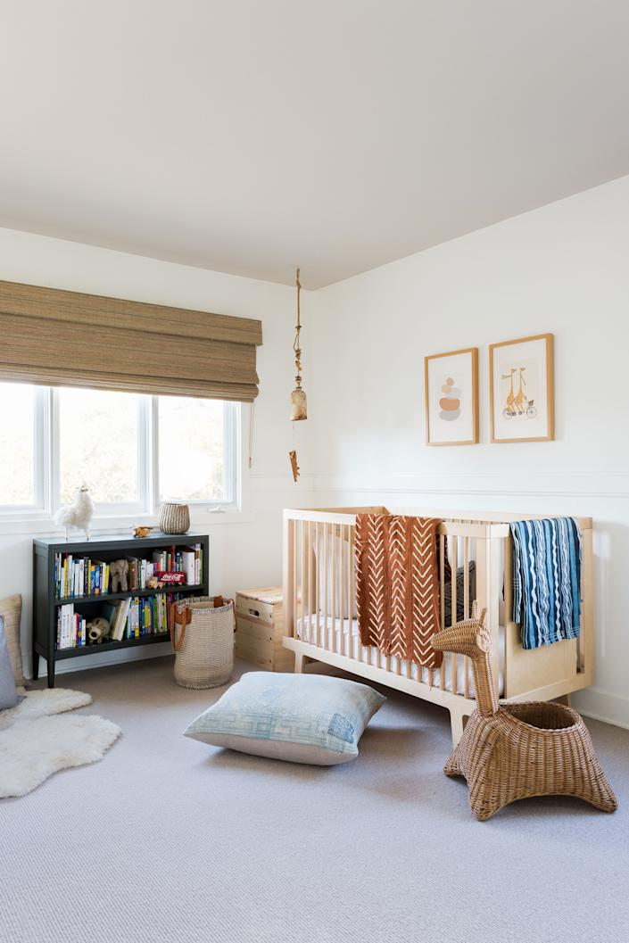 "<div class=""caption""> ""We wanted to create a neutral palette that would transition well to a big-boy room,"" Elliott says of son Logan's room. His crib is from <a href=""https://oeufnyc.com/"" rel=""nofollow noopener"" target=""_blank"" data-ylk=""slk:Oeuf"" class=""link rapid-noclick-resp"">Oeuf</a> and covered with vintage throws that were sourced by Boesch. The art was procured from <a href=""https://society6.com/"" rel=""nofollow noopener"" target=""_blank"" data-ylk=""slk:Society6"" class=""link rapid-noclick-resp"">Society6</a> and the bookcase is from <a href=""https://www.crateandbarrel.com/kids/"" rel=""nofollow noopener"" target=""_blank"" data-ylk=""slk:Crate & Kids"" class=""link rapid-noclick-resp"">Crate & Kids</a>. </div>"