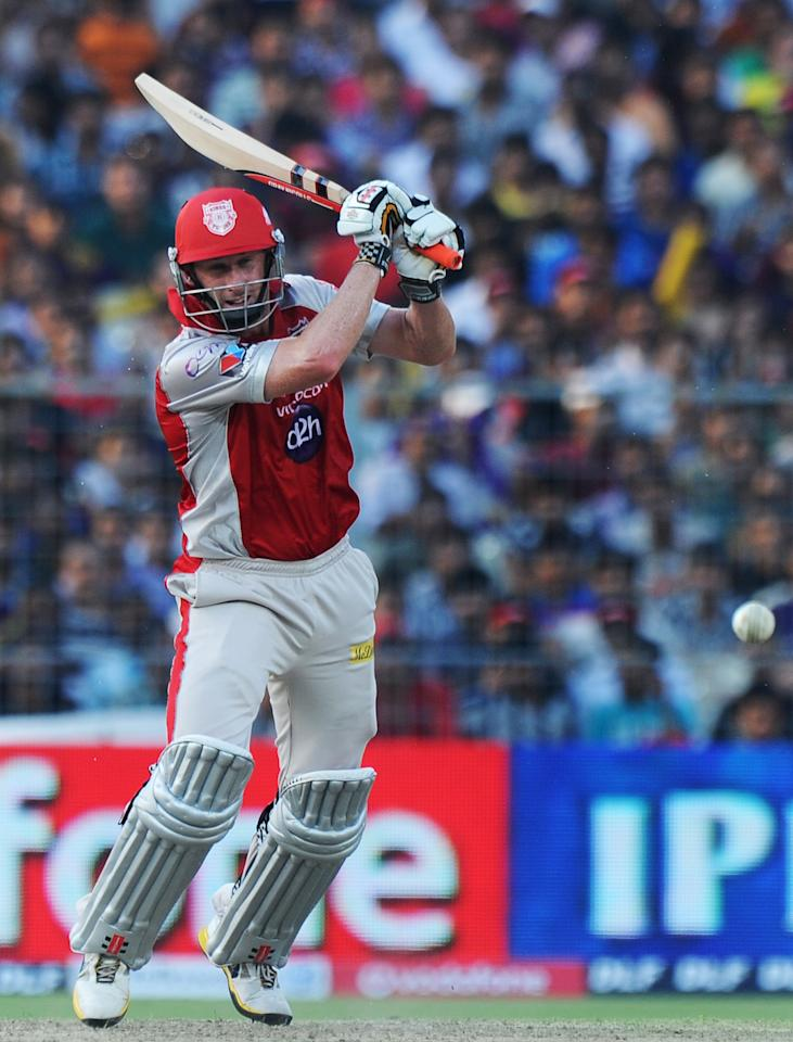 Kings XI Punjab batsman David Hussey plays a shot during the IPL Twenty20 cricket match between Kolkata Knight Riders and Kings XI Punjab at The Eden Gardens in Kolkata on April 15, 2012. RESTRICTED TO EDITORIAL USE. MOBILE USE WITHIN NEWS PACKAGE. AFP PHOTO/Dibyangshu SARKAR (Photo credit should read DIBYANGSHU SARKAR/AFP/Getty Images)