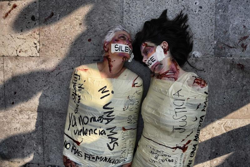 """Spanish artist and activist aka """"Jil Love"""" and Mexican activist Julia Klug perform during a protest against femicides in Mexico City in 2017. Source: Getty"""