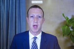 Mark Zuckerberg appears on a screen