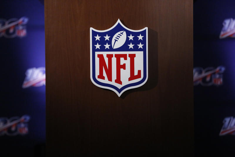 NFL logo on a wooden board.
