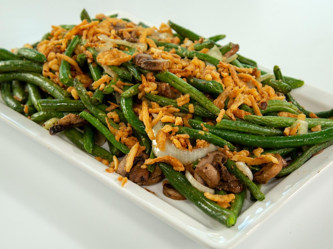 """<p>Hate creamy casseroles? This spin on traditional green bean casserole isn't just lightened and faster. It comes out tasting like a hearty roasted vegetable dish with the perfect balance of tenderness and crisp. The mushrooms and onions are nicely softened rather than mushy, and everything comes together thanks to the crunch and slight saltiness from the fried onions. It also makes a great, quick side dish for a weeknight. </p> <p><a href=""""https://www.myrecipes.com/recipe/air-fried-green-bean-casserole"""">Air Fried Green Bean Casserole Recipe</a></p>"""
