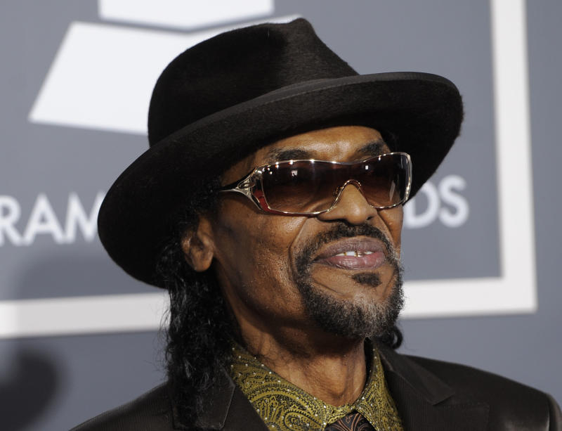 """FILE - In this Feb. 13, 2011 file photo, Chuck Brown arrives at the 53rd annual Grammy Awards in Los Angeles. Brown, who styled a unique brand of funk music as a singer, guitarist and songwriter known as the """"godfather of go-go,"""" died Wednesday, May 16, 2012 after suffering from pneumonia. He was 75. (AP Photo/Chris Pizzello, File)"""