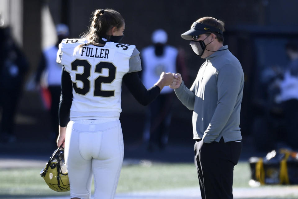 Vanderbilt place kicker Sarah Fuller (32) gets a fist-bump from Missouri head coach Eliah Drinkwitz after warming up before an NCAA college football game Saturday, Nov. 28, 2020, in Columbia, Mo. (AP Photo/L.G. Patterson)