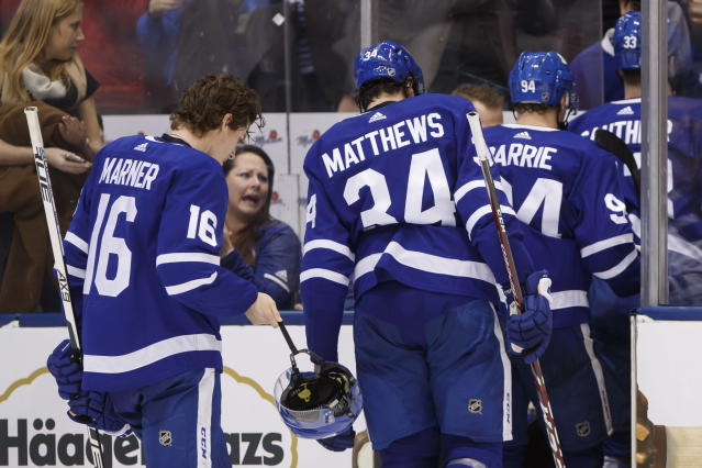 Toronto Maple Leafs right wing Mitchell Marner (16) and teammates leave the ice after losing to the New York Rangers in overtime NHL hockey game action in Toronto, Saturday, Dec. 28, 2019. (Cole Burston/The Canadian Press via AP)