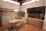 <p>Fans will recognize the floral curtains, wooden chairs, and beige walls of the Soprano's eat-in kitchen. Zoom out further and you'll find panels of studio lights and an open sound stage ceiling.</p>