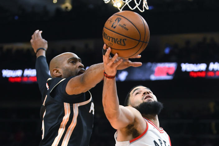 Atlanta Hawks guard Vince Carter blocks a shot by Toronto Raptors guard Fred VanVleet (23)during the second half of an NBA basketball game Monday, Jan. 20, 2020, in Atlanta. Toronto won 122-117. (AP Photo/John Amis)