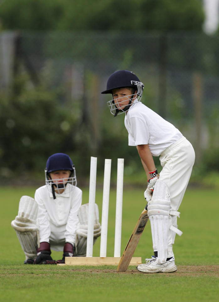 LONDON - AUGUST 14: A young cricketer looks on at The Spencer Club on August 14, 2005 in London. (Photo by Clive Rose/Getty Images)