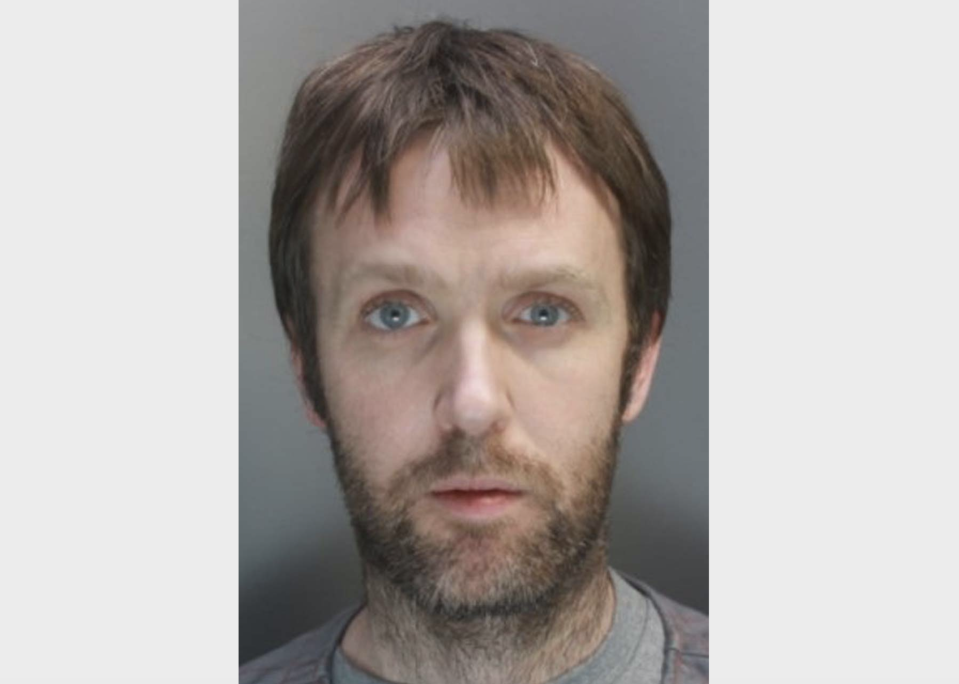 Robert Child who killed his mother in a violent hammer attack before transferring £25,000 from her bank account. (PA/Merseyside Police)