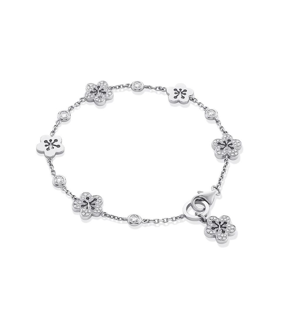 """<p><a class=""""link rapid-noclick-resp"""" href=""""https://www.boodles.com/blossom-charm-bracelet/"""" rel=""""nofollow noopener"""" target=""""_blank"""" data-ylk=""""slk:SHOP NOW"""">SHOP NOW</a></p><p>White-gold blooms, dainty diamonds and a sweet swinging blossom at the clasp – could Boodles' daisy chain be any more charming?</p><p>Charm bracelet, £5,600, Boodles.</p>"""