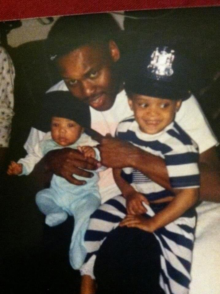 Neyland Vaughn poses with his daughters, Jasmine (left) and Amanda (right), in between shifts as a Baltimore police officer.
