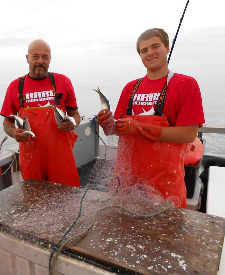Gloucester, MA - Hard Merchandise Owner/Captain Dave Marciano, left, and his son, Joe, are getting bait ready.