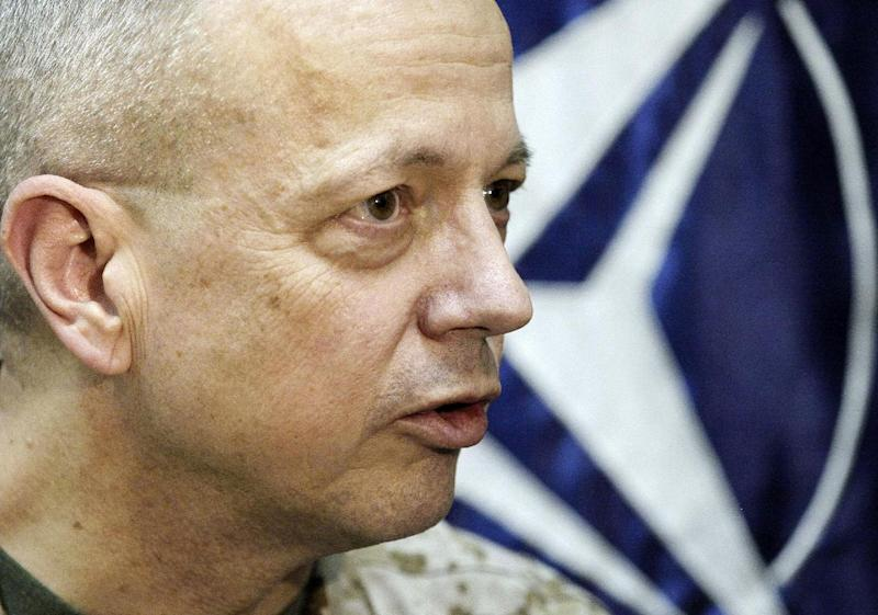 FILE - In this Jan. 27, 2013 file photo, U.S. Marine Gen. John Allen, then-the top commander of U.S.- and NATO-led International Security Assistance Force (ISAF) troops in Afghanistan, speaks during an interview with The Associated Press in Kabul, Afghanistan. Allen called on the White House Friday to announce how many troops it intends to leave in that country after 2014. Allen said Afghans need certainty on how many U.S. troops will stay behind after the majority complete their withdrawal by Dec. 31, 2014, before they will choose to side with the Afghan government or the Taliban. (AP Photo/Musadeq Sadeq, File)