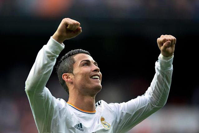 MADRID, SPAIN - NOVEMBER 09: Cristiano Ronaldo of Real Madrid CF celebrates scoring their fifth goal during the La Liga match between Real Madrid CF and Real Sociedad de Futbol at Estadio Santiago Bernabeu on November 9, 2013 in Madrid, Spain. (Photo by Gonzalo Arroyo Moreno/Getty Images)
