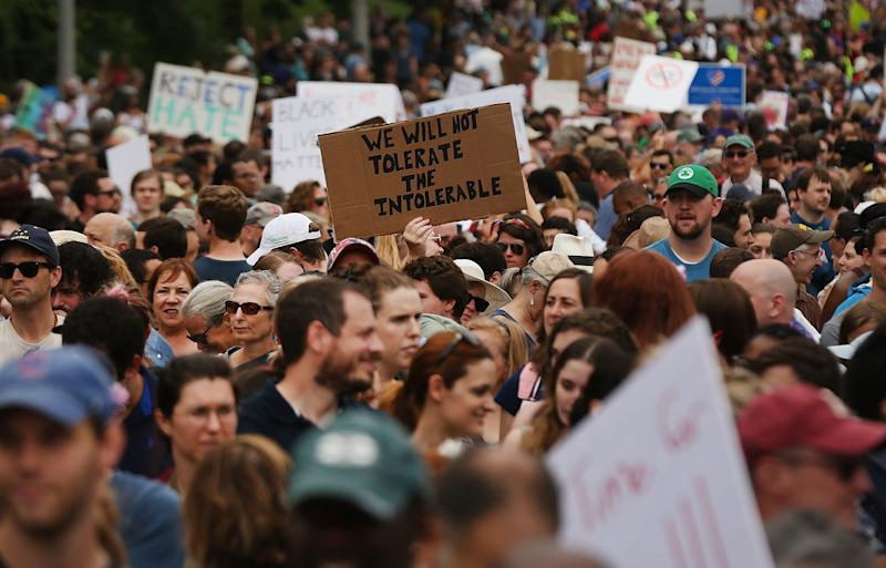 """Thousands of protesters gathered in Boston last year to march against a planned """"Free Speech Rally"""" just one week after the violent """"Unite the Right"""" rally in Virginia left one woman dead and dozens more injured. (Spencer Platt via Getty Images)"""