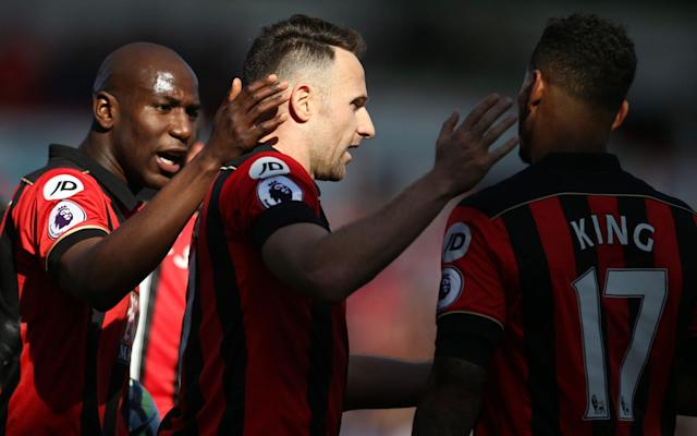 <span>Marc Pugh (centre) is congratulated y team-mates after scoring Bournemouth's third</span> <span>Credit: PA </span>