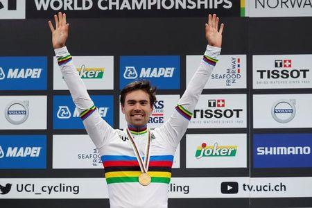 Cycling - UCI Road World Championships - Men Elite Individual Time Trial - Bergen, Norway - September 20, 2017 - Gold medalist Tom Dumoulin of the Netherlands reacts on the podium. NTB Scanpix/Cornelius Poppe via REUTERS
