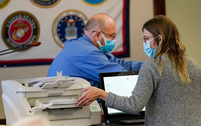 Municipal workers scan Luzerne County ballots in Wilkes-Barre, Pennsylvania - Mary Altaffer/AP